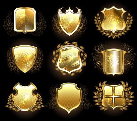 Set of golden shields on a black background.