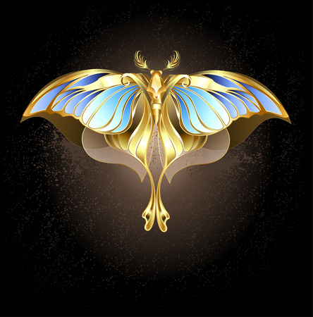moth of gold and bronze with glass, blue wings on a dark background.