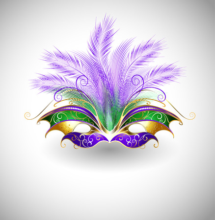 bright mask with purple and green feathers, decorated with gold pattern on a light background