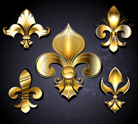 Set of gold, jewelry Fleur de Lis on a black background.