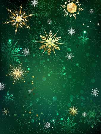 sparkling: gold jewelry snowflakes on green textural background