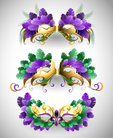 green and purple: Set of isolated colorful masks decorated with purple, green, yellow feathers. Festival Mardi Gras.