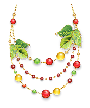 Necklace made of gold chains, decorated with green, autumn leaves and green, red, orange beads made of precious stone on a white background. Design of jewelry.