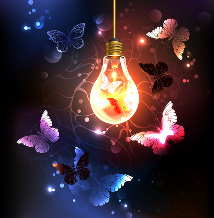 Glass bulb with night butterflies on a dark luminous background. Night butterflies. Design with butterflies.
