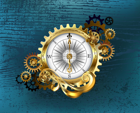 Antique compass with gold and brass gears on turquoise wooden background.