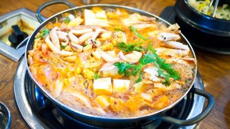 pot belly: Korean food kimchi stew, kimchi chigae, korean cuisine , squid ,crab, shrimp Stock Photo