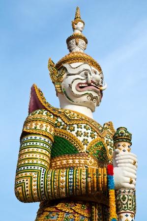 Demon Guardian at wat Arun in Bangkok Thailand photo