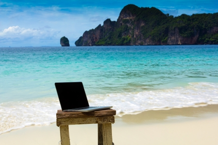 mobility: Computer notebook on beach - business travel background , Krabi ,Thailand