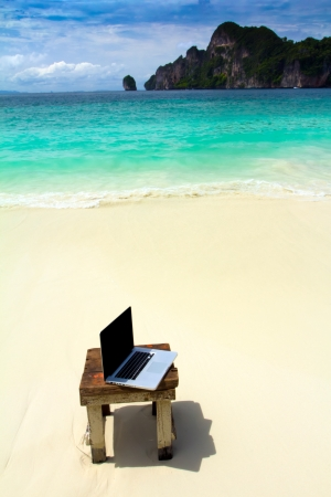 Computer notebook on beach - business travel background , Krabi ,Thailand