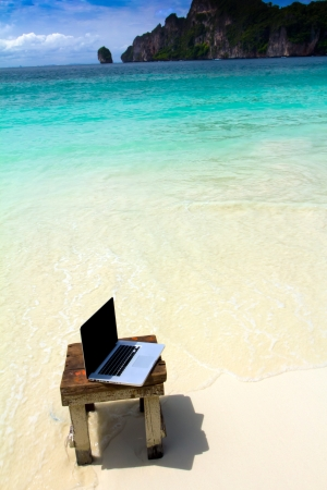 Computer notebook on beach - business travel background , Krabi ,Thailand photo