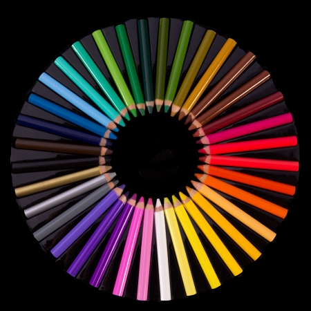 close up of Colouring crayon pencils  on black background with  photo