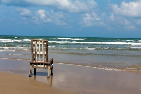 One wooden canvas chair on a beautiful tropical beach