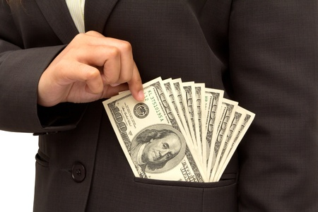 Business woman putting dollar bills U S  banknotes into her pocket on white background  photo