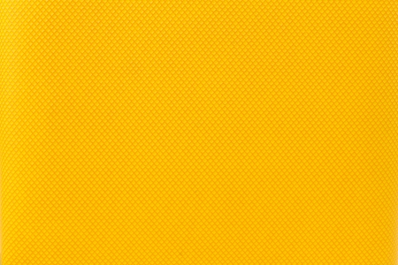 Macro of a yellow colour graphic grid  against background texture photo