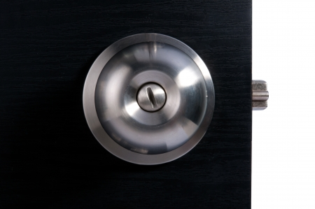 Aluminium door knob on the black door white background  Stock Photo