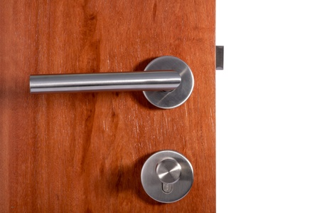 door handle: Aluminium door knob on the black door white background  Stock Photo