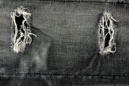 Detail of torn Black denim, front view  jean  background or texture Stock Photo - 13984393