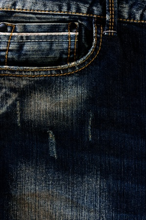Detail of torn Blue denim, front view  jean  background or texture Stock Photo - 13984386