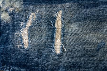 Détail de denim déchiré, sur fond bleu devant vue jean ou de la texture Banque d'images - 13984405