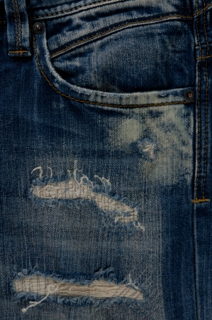 Detail of torn Blue denim, front view  jean  background or texture Stock Photo - 13984384