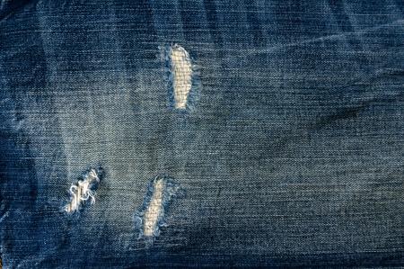 Detail van gescheurde Blue denim, vooraanzicht jean achtergrond of textuur Stockfoto
