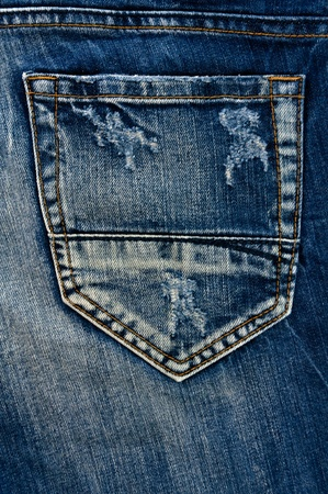Detail of torn Blue denim, front view  jean  background or texture photo