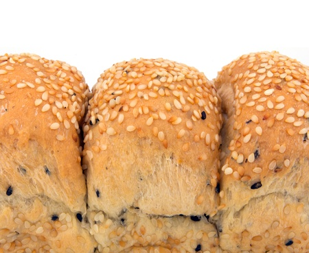white sesame seeds: Loaf of Sesame Bread with White Sesame Seeds and Black Sesame Seeds Isolated on White Background Stock Photo