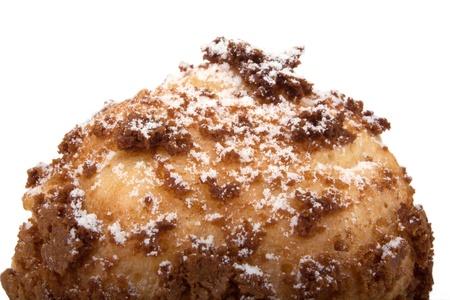 Choux cream Bigne stuffed with pastry cream icing sugar on top photo