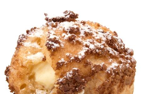 choux bun: Choux cream Bigne stuffed with pastry cream icing sugar on top Stock Photo