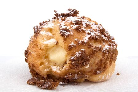 Choux cream Bigne stuffed with pastry cream icing sugar on top Stock Photo