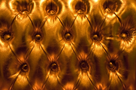 Luxury golden leather upholstery of a magnificent sofa close-up background Stock Photo - 14121135