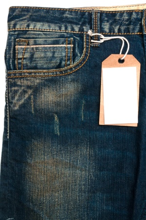 Blue jeans detail blank tag paper jeans label on white background photo