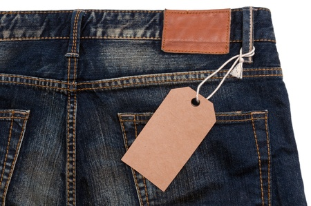 Blue jeans detail blank tag paper jeans label on white background Stock Photo