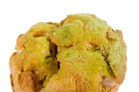 bigne: Green tea Choux cream Bigne stuffed with pastry cream icing sugar on top
