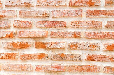 Orange old brickwork closeup,brick grunge wall background Stock Photo