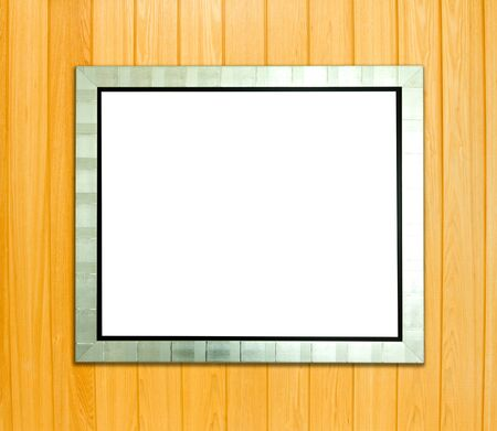 Blank silver picture frame on wood background  photo