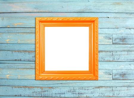 Orange Vintage picture frame, wood plated, blue wood background photo