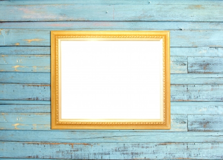 Gold Vintage picture frame, wood plated, blue wood background photo