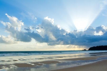 lake shore: Tropical beach Sunset Sky With Lighted Clouds Stock Photo