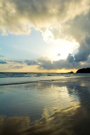 anse source d argent: Tropical beach Sunset Sky With Lighted Clouds Stock Photo