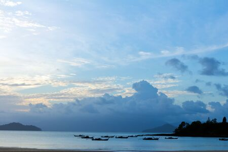 Tropical beach Sunset Sky With Lighted Clouds photo
