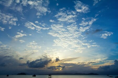 d argent: Tropical beach Sunset Sky With Lighted Clouds Stock Photo