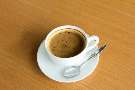 Coffee collection - Espresso Cup. Isolated on old white wood background photo