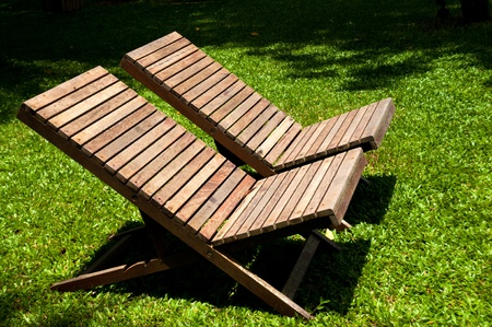 Wooden Lawn Chairs In The Spring Garden. Photo