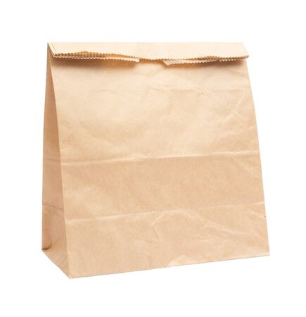 Recycled Shopping paper bag isolated on white background photo