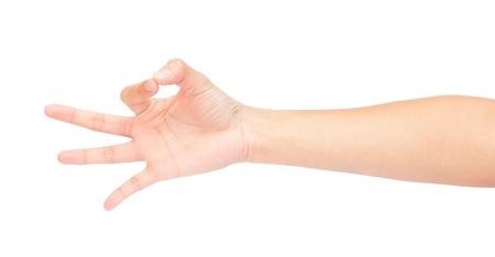 Mooie vrouw hand met duim en wijsvinger samen simuleren bedrijf of plukken iets omhoog, geïsoleerd op witte achtergrond Stockfoto