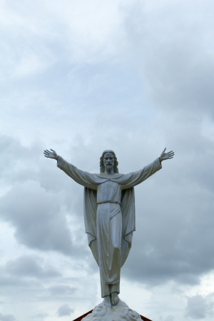 Statue of Jesus Christ appears in the clouds  Christianity symbol Stock Photo