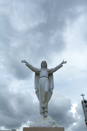 risen christ: Statue of Jesus Christ appears in the clouds  Christianity symbol Stock Photo