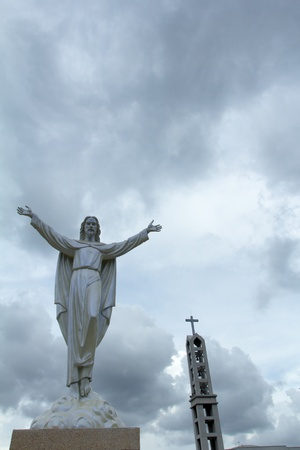 risen: Statue of Jesus Christ appears in the clouds  Christianity symbol Stock Photo