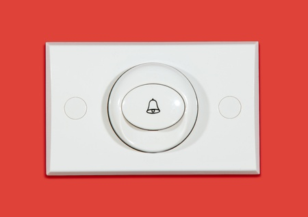 guest house: Door bell on red background